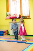 Two Kids In Montessori Preschool Class. Little Girl And Boy Playing In Kindergarten