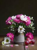 Summer Flowers In A Ceramic Vase.