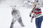 foto of snowball-fight  - Couple in a snowball fight - JPG