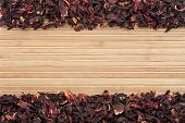 Dried  Hibiscus  On  A  Light  Bamboo Mat