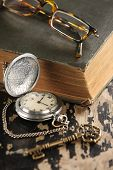 vintage pocket watch old book and brass Key