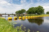 Barrage In Dutch River Vecht With Floating Barricade