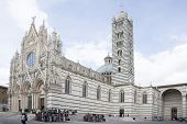 Tourists Visiting Siena Cathedral, Dedicated To The Assumption Of The Blessed Virgin Mary