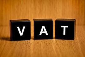 stock photo of tariff  - VAT or value added tax text on black block - JPG