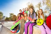 Group of children with skateboards and helmet