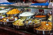 stock photo of buffet lunch  - Buffet lunch in Turkish restaurant of bulgur coos coos peppers stews soup and meat dishes near Pergamum Turkey - JPG