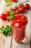 stock photo of bloody  - Bloody Mary Alcoholic Drink with fresh tomatoes - JPG