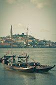 Wine Barrels In An Old Boat In Porto