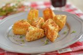 Roasted pieces of Camembert cheese with thyme