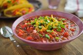 Chili con carne with Cheddar cheese and green onion