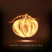 Happy Thanksgiving Day celebration concept with shiny golden pumpkin on brown background.