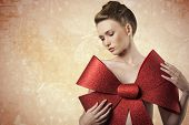 picture of adornment  - christmas shoot of sensual young girl adorned like a present with elegant hair - JPG