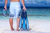 picture of peace-pipe  - Handsome man on the beach holding fin and pipe - JPG