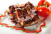 Hot Meat Dishes - BBQ Ribs with Tomatoes and Spicy Sauce