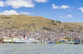PUNO, PERU, MAY 5, 2014: General view of Puno port with boats mooring at harbor