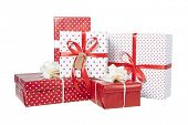 Stack of Christmas gifts isolated on white background