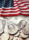 American flag, banknotes and coins
