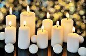 Nine Burning Candles On A Dark Shiny Background