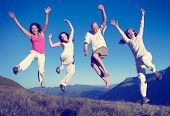 Group of People Jumping Happines Outdoors Concept