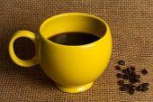 Coffee Mug Closeup - Yellow Mug With Beans