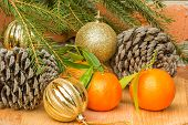 Cones, Tangerines And Christmas Balls And Spruce Branch