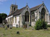 English Gothic stone church and churchyard