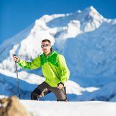 Man Climbing Exploring Winter Mountains