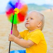 Baby playing with toy windmill