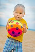 Baby playing with toy ball