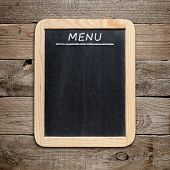 Blackboard Menu On Old Wooden Background