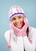 Portrait of pretty woman in winterwear looking at camera with smile