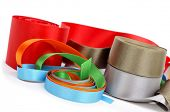some satin ribbons of different colors on a white background