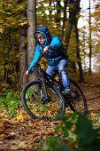 Extreme cyclist autumn