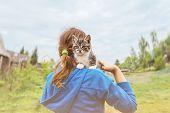 Kitten Sitting On Shoulder Of Little Girl