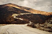 stock photo of long winding road  - Winding road in the mountains autumn season - JPG