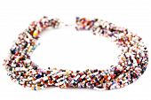 Multicolored Multistrand Twisted Beaded Neckwear, Traditionally African, Isolated on White Backgroun