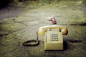image of phone-booth  - Dirty old phone on the floor and old concrete - JPG