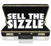 Sell the Sizzle 3d words in a black leather briefcase for a sales presentation that touts the customer's benefits and desires of a product or service