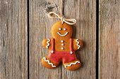 Christmas homemade gingerbread man over wooden background