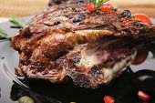 baby ribs served on plate over wooden table