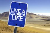 Live a Colorful Life sign with a desert background