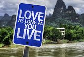 Love As Long As You Live sign with a exotic background