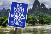 Be With Who Makes You Smile sign with a exotic background