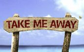 Take me Away sign with a beach on background