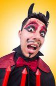 Man in devil costume in halloween concept
