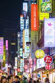 SEOUL, SOUTH KOREA - FEBRUARY 14, 2013: Myeong-Dong district at night. The location is the premiere district for shopping in the city.