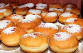 picture of hanukkah  - classic Hanukkah sufganiyot filled with strawberry jelly