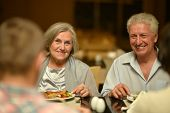 stock photo of amusement  - Portrait of a amusing old couple in cafe - JPG