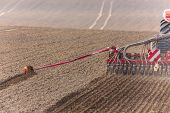 pic of tractor  - The tractor working on the large field - JPG