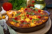 image of lasagna  - Freshly baked lasagna on the table close up - JPG